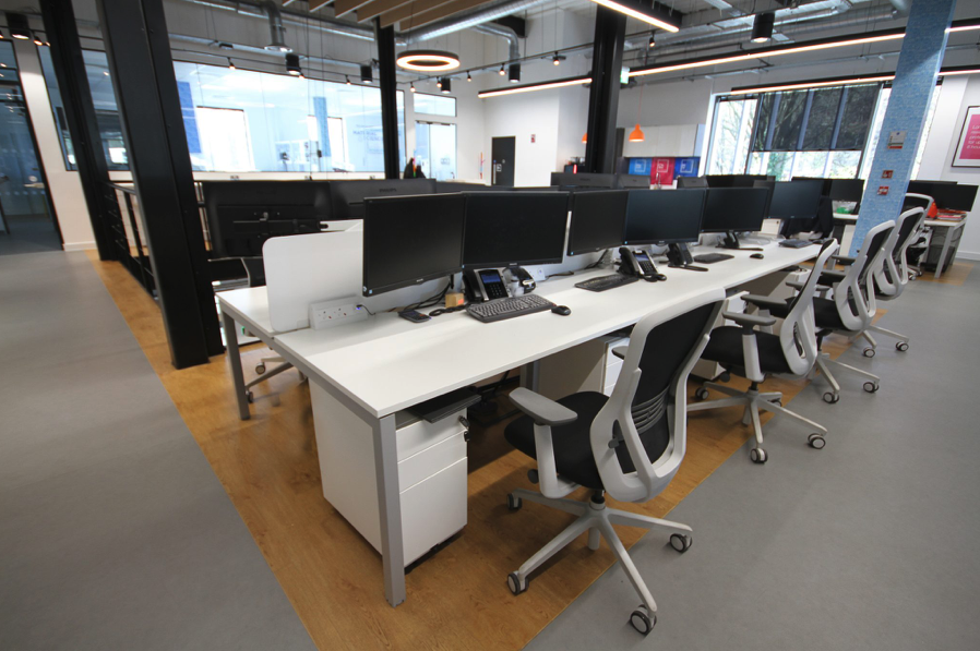 Image shows a very tidy desks workspace - fit out and design by Ben Johnson Interiors